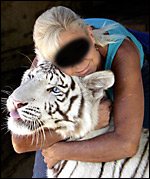 Gloria Johnson Hugs Tiger