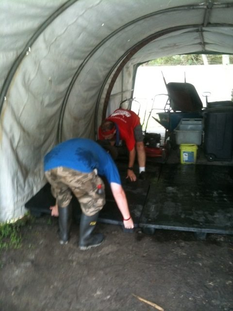 Callum and Kev Raising Floor in Bucket Shed