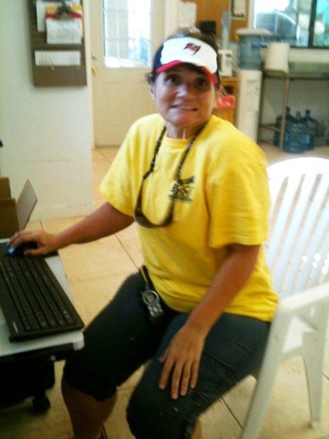 Volunteer Lynda logs in her observations for the day in food prep