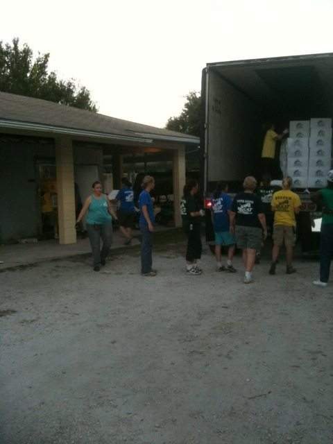 "Unloading thousands of pounds of ""cat food"" in the early morning light"
