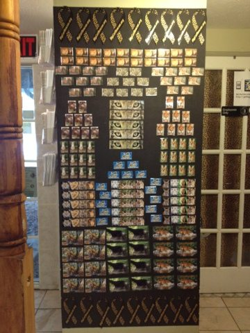 Partner Volunteers create a lovely display of magnets in the gift shop