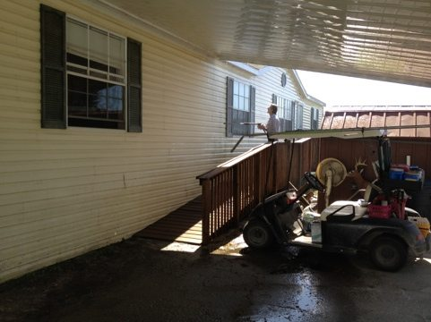 Staff pressure washes the Lion's Lair Party Pavilion at BCR