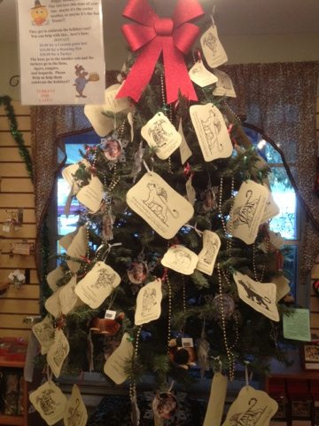 People can buy turkeys for the cats and hang there receipt on the tree