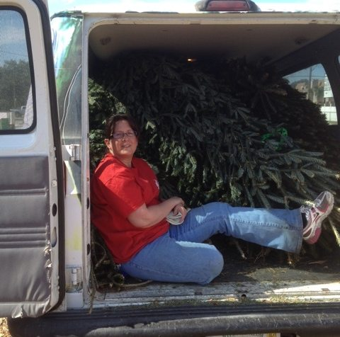 Kathryn helps Gale pick up donated Christmas trees