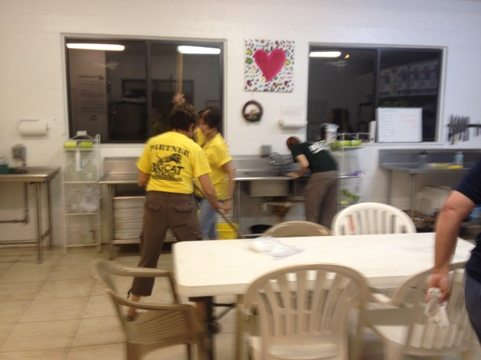 Enrichment Committee cleans up food prep after finishing present making