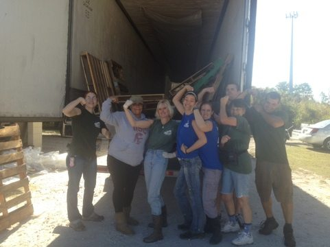 This happy crew just unloaded a semi of lumber and one of meat