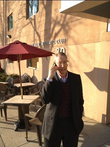 Howie takes a call outside the Democratic Club in Washington, DC