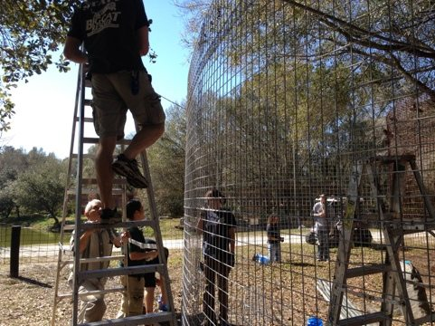 Chris, Gale and Army Volunteers building bobcat room addition