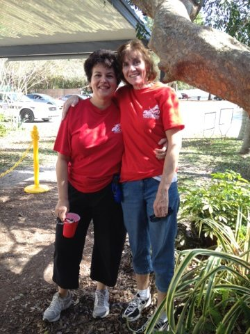 Michelle and new Red Level Volunteer at the Check In station