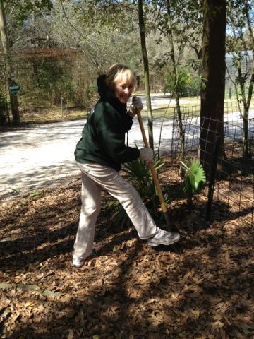 Phyl lends a smile, a hand and a shovel to the beautification project
