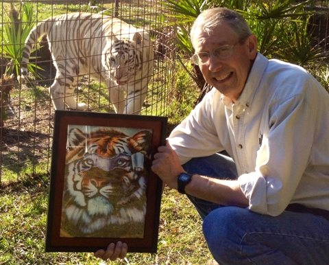 Lies Beneath is a clever painting that illustrates the lies white tiger breeders tell
