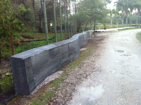 New section of memorial wall in front of tigers serves as barricade