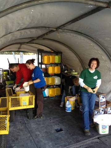 Volunteers get ready for cleaning by loading up buckets, tongs, bags