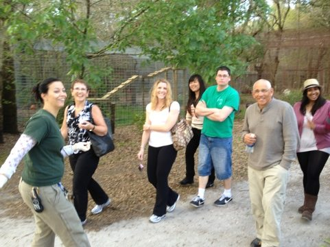 Jennifer leading a feeding tour group around the sanctuary