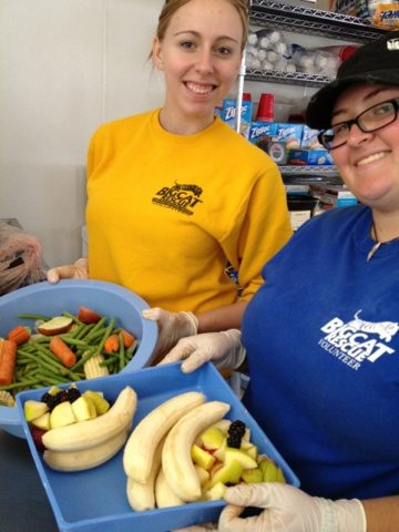 Big Cat Rescue Volunteers and Interns prepare omnivore food