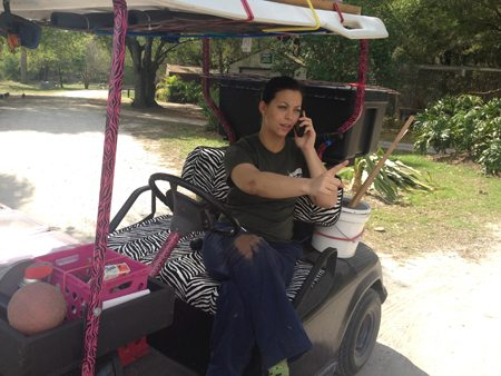 Jennifer Flatt kidding around on Jamie's golf cart