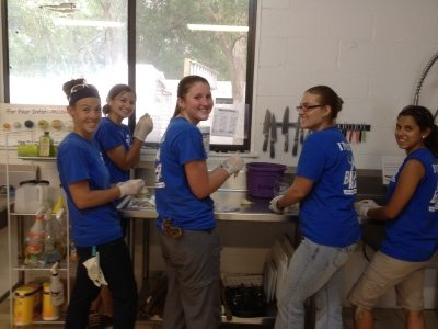 Interns prepare dinner for the big cats