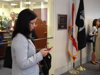 Jennifer checks facebook in between meetings with her lawmakers