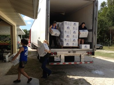 Organized volunteers offload the meat trucks in record time