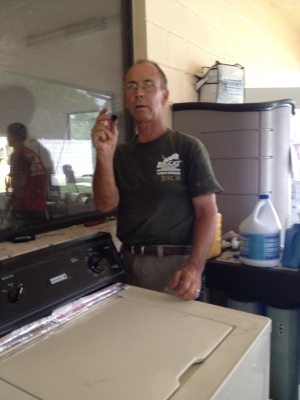 Remarkable Rich fixes the washing machine for cat laundry