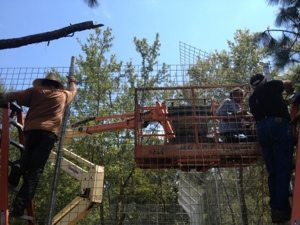Chuck, Scott and Vern putting cantilever in place