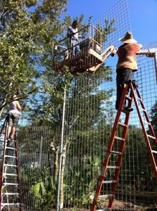 Carole, Scott & Chuck install 45 degree angle caging