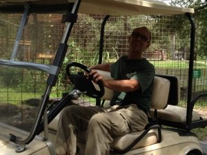 Green Level Rich Bluder drives by on golf cart