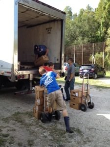 Volunteers unload the meat truck