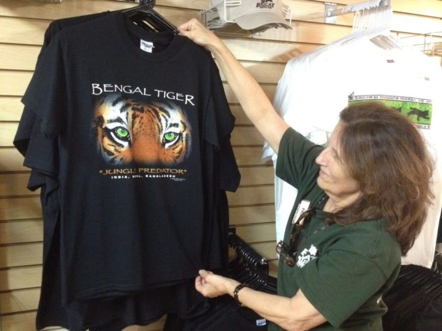 Pam Rodrigues stocks the Trading Post Gift Shop w/ cool shirts