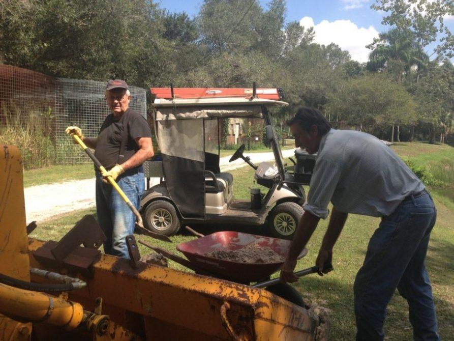 Vern & Scott haul dirt behind tigers to revamp pools