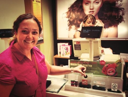 Jamie Veronica voting for Big Cat Rescue in Body Shop store