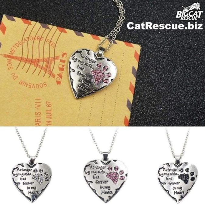 """Shop CatRescue.biz and Fund the Freedom Fight with every purr-chase! Proceeds from this site help us with legislative efforts to create better laws to protect Big Cats! Remember your beloved cat when you wear this beautiful paw heart remembrance necklace """"No longer by my side but forever in my heart"""". https://catrescue.myshopify.com/products/no-longer-be-my-side-but-forever-in-my-heart-pink-white-silver-crystal-cat-paws-print-heart-necklace"""